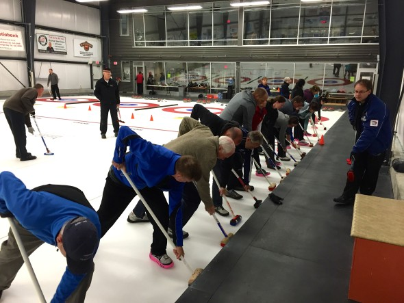 New curlers practice sweeting techniques at Learn-to-Curl clinic